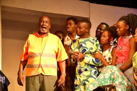 Phillip Luswata with a chorus/ group cast in the 2019 production