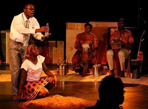 Esteeri Tebandeke (as Maria) and Tonny Muwangala (as Silver) in Cooking Oil at The National Theatre Kampala